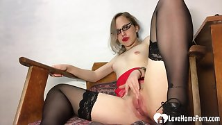 Amazing teacher in stockings pleasures her racy snatch